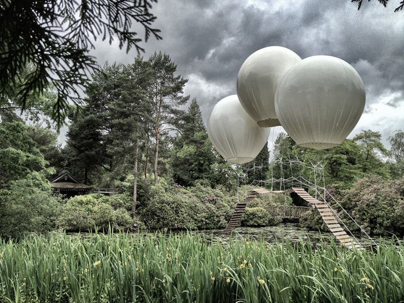 "French designer Olivier Grossetet used three huge helium balloons to hang the ""Monkey Bridge"" over the lake in Tatton Park, a historic estate in north-west England."