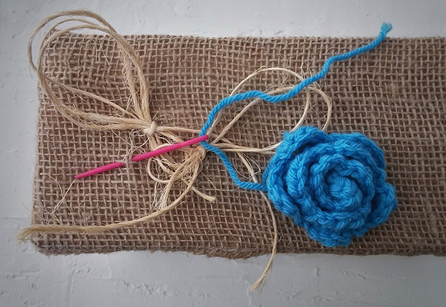 sew the flowers to the burlap box