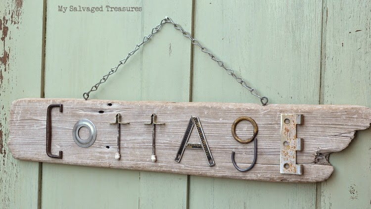 Salvaged junk and driftwood Cottage sign