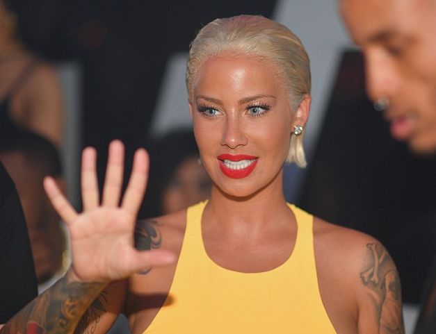 Sensational Amber Rose Debuts New Hair Do In All Mushy Display With Terrence Short Hairstyles For Black Women Fulllsitofus