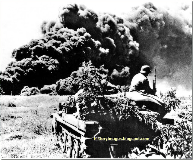 German soldiers  armored Sd.Kfz.251 Maiko oilfields burning August 1942