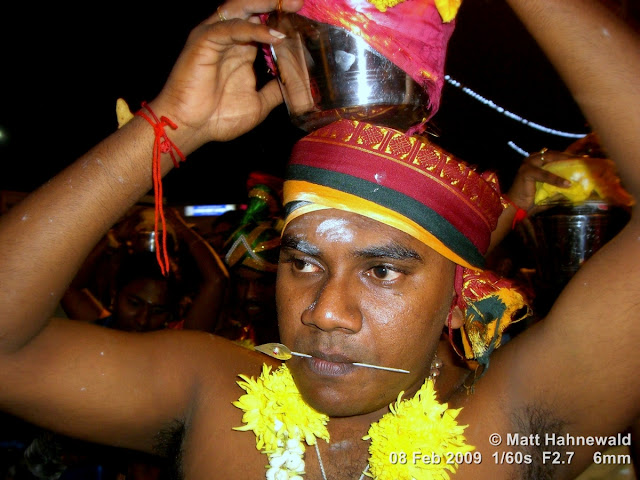 Thaipusam Festival, Malaysia, Kuala Lumpur, Batu Caves, kavadi attam, ceremonial sacrifice, ceremonial offering, Tamil man, Hindu man, Malaysian Indian man, street portrait, ritualised piercing, ritualised mutilation, self-mutilation