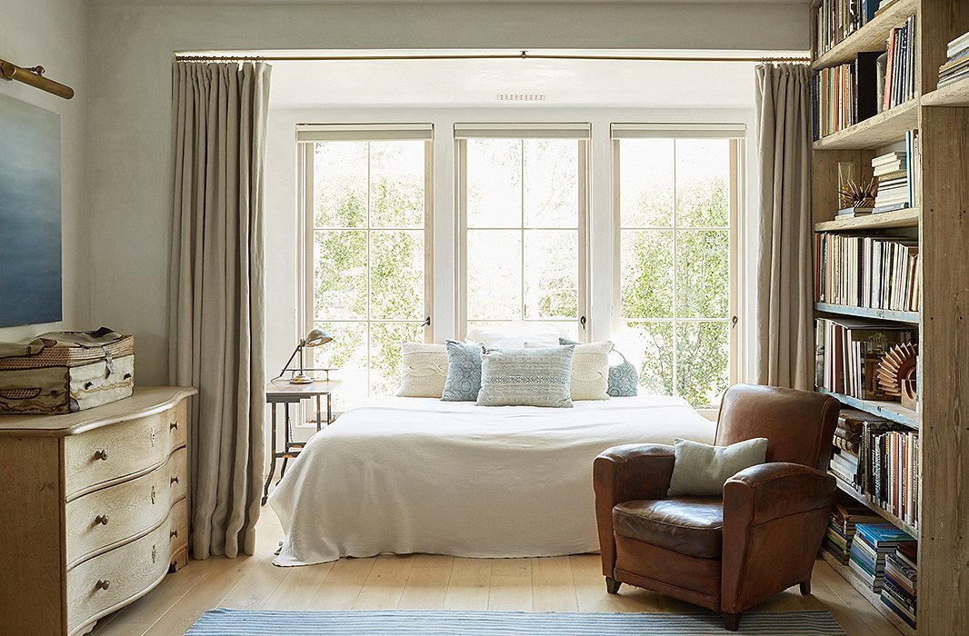 Beautiful modern farmhouse bedroom at Patina Farm...decor inspiration on Hello Lovely Studio