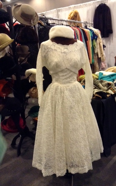 An vintage white dress and fur hat at the Victoire booth at the Ottawa Vintage Clothing Show