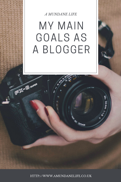 "pinnable image with a picture of a camera and the words ""my main goals as a blogger"""