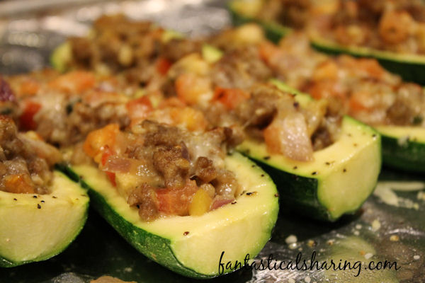 Grilled Stuffed Zucchini // Fire up the grill and load up some zucchini for a delicious summer meal! #recipe #grill #zucchini #sausage