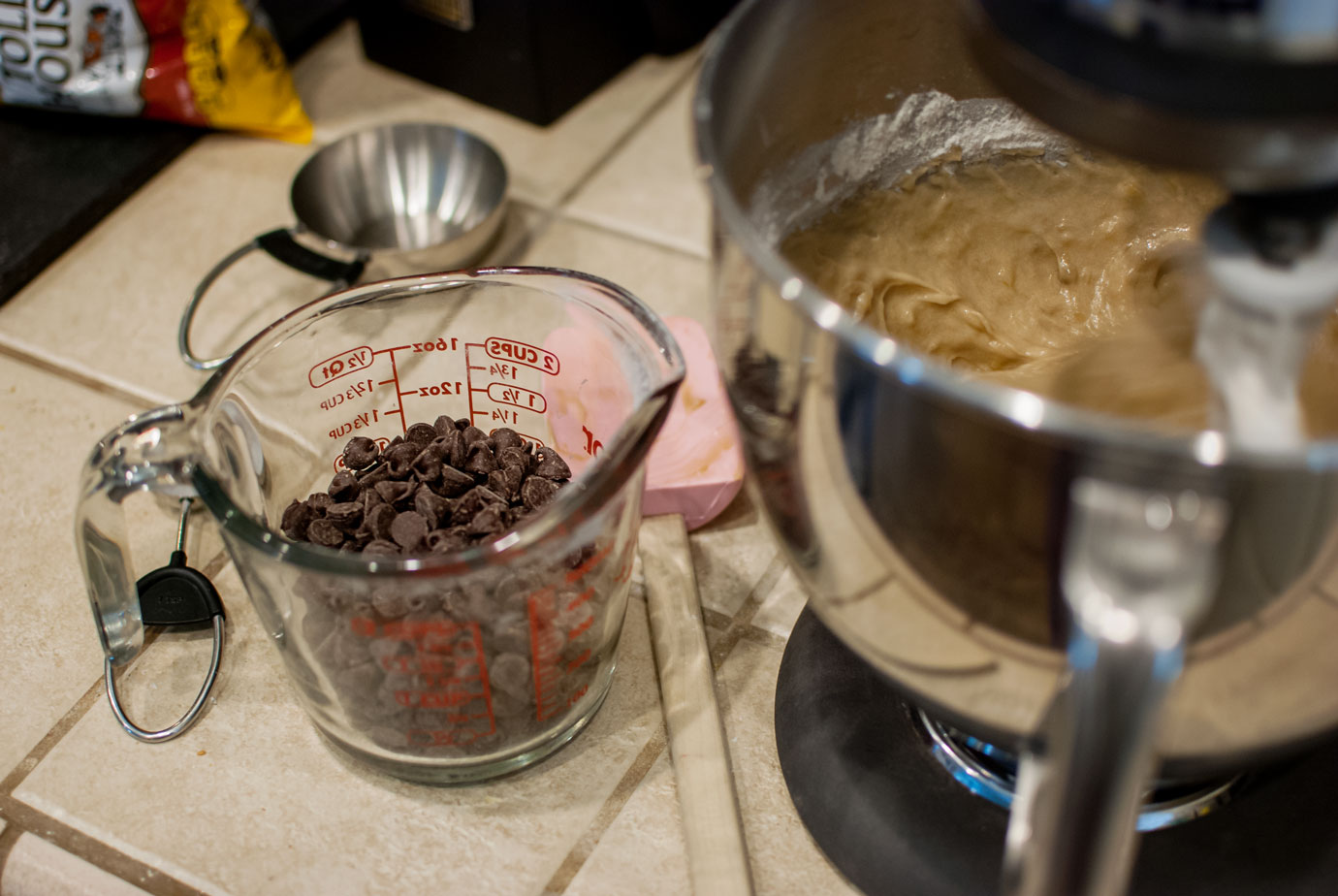 Chocolate Chips In A Measuring Cup For Banana Bread Recipe