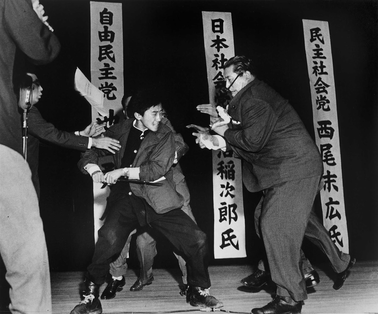 On 12 October 1960, the 17-year-old extreme right-wing student Otoya Yamaguchi kills the socialist politician Inejiro Asanuma with a sword during a speech in Tokyo.