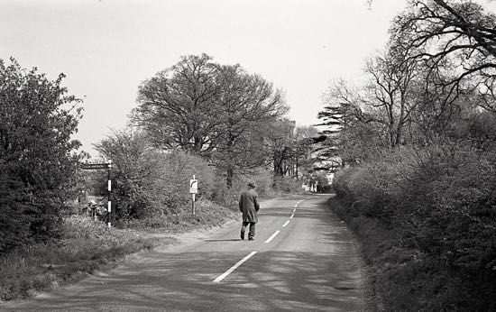 Photograph of Man walking east along Hawkshead Road close to Folly Arch, Little Heath, May 1967 Image by Ron Kingdon, part of the Images of North Mymms collection