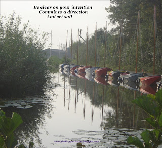 Image of coloured sail boats in a row on a river with the text Be Clear on your intention, commit to a direction, And set sail