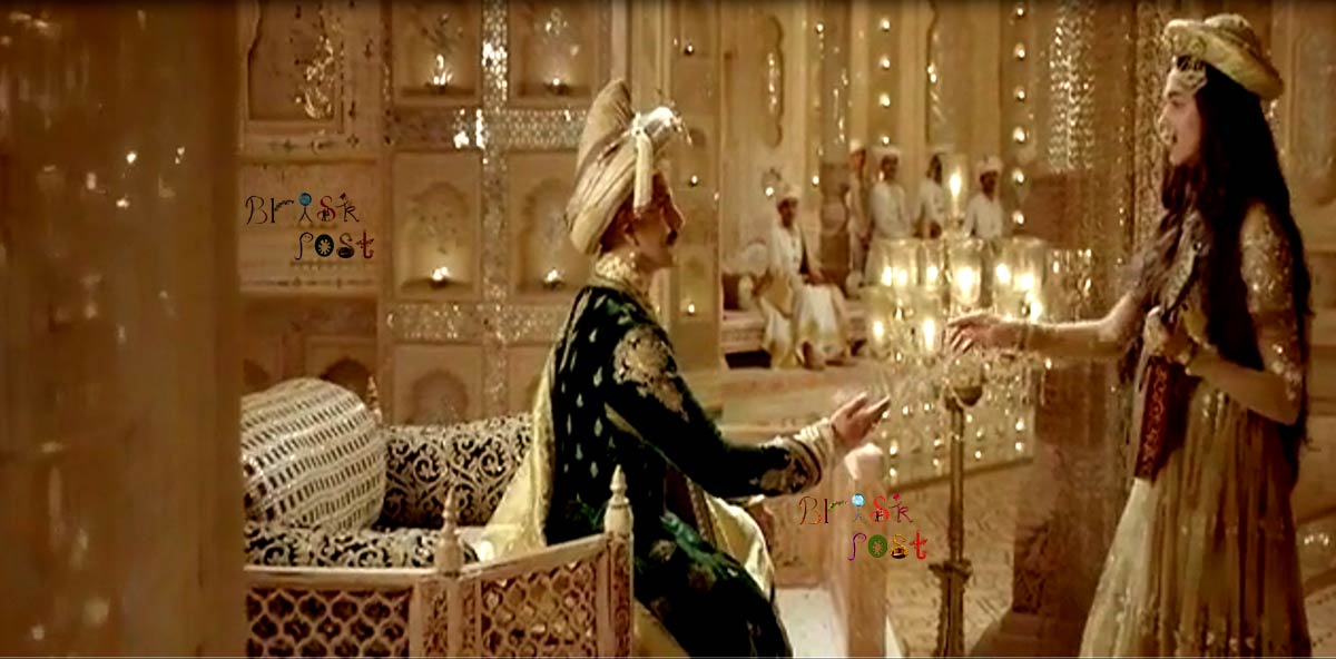 Deepika Padukone shaking hands as Mastani with Ranveer Singh playing Bajirao in between Deewani Mastani song
