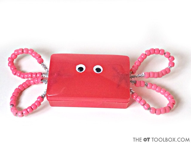 Use beads and a travel soap holder to make a fine motor craft that builds skills kids need.