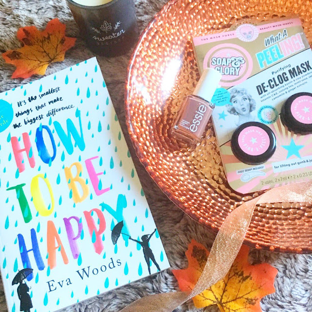 Autumnal flatlay - nail polish, face mask, book