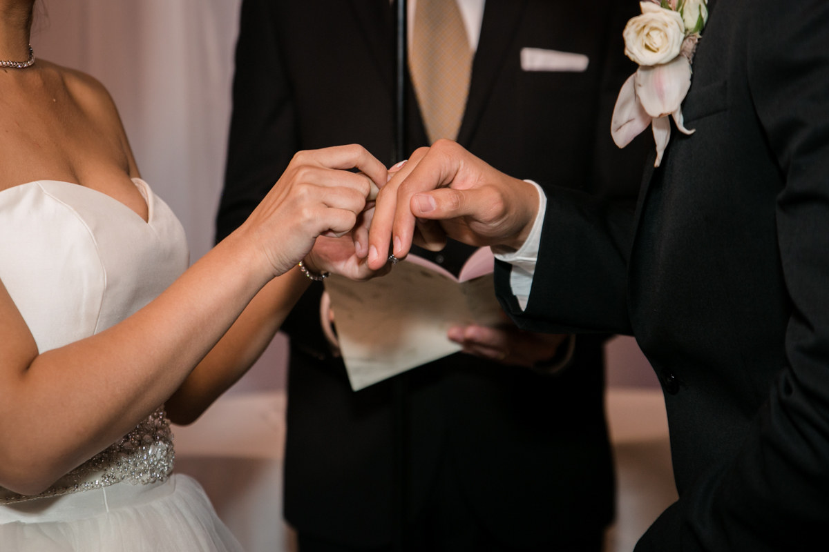 The bride exchanging ring as a seal of her love for the groom