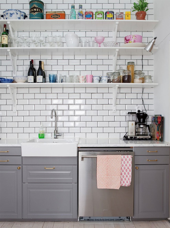 Kitchen subway tiles and open shelving. Photo via Bolaget.