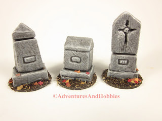 Front view of three graveyard monuments for 25 to 28mm scale wargames.