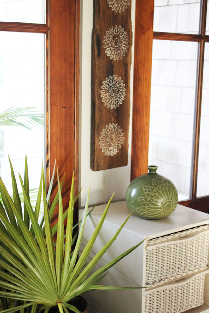 stenciled reclaimed wood plank simple nature decor