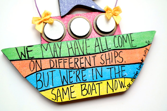 Dr. Martin Luther King Quote Same Boat Painted Chipboard Boat Hanging by Dana Tatar for Tando Creative