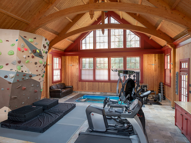 Man Cave with fitness equipment, climbing wall, and inground Endless Pools swimming machine