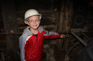 boy in a mine with a hard hat