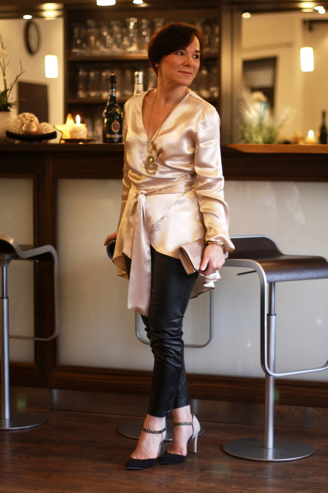 Christmas party look. Satin blouse and faux leather trousers