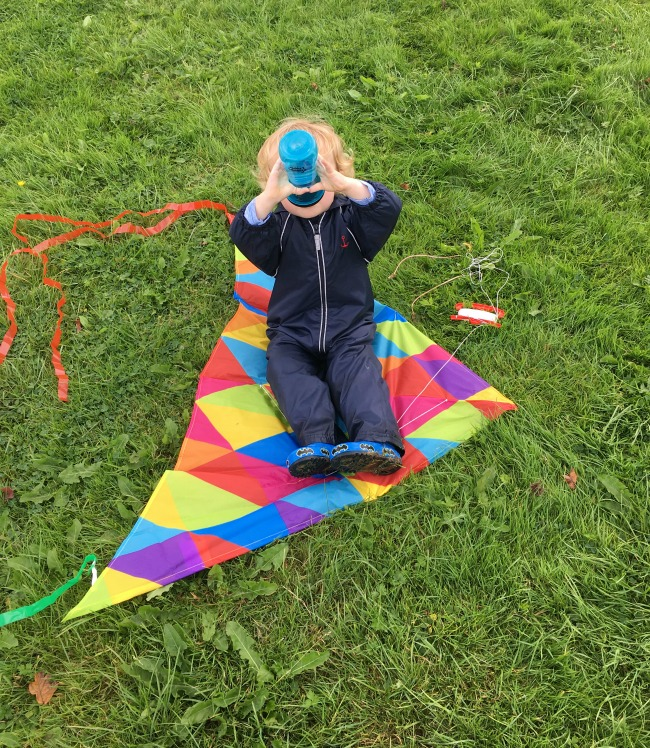 toddler-sat-on-kite-drinking-from-tommee-tippee-filter-cup