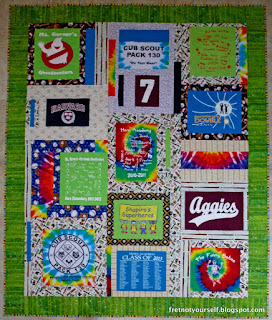 Colorful t-shirt quilt sashed with baseball prints. Wide green border, striped binding.