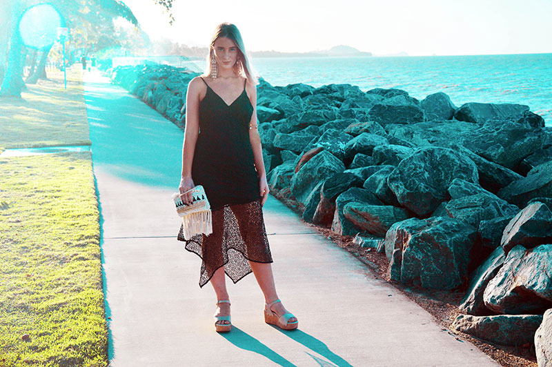 black lace dress styled with wedge heel sandals beachy shell clutch evening summer holiday vacation outfit australia