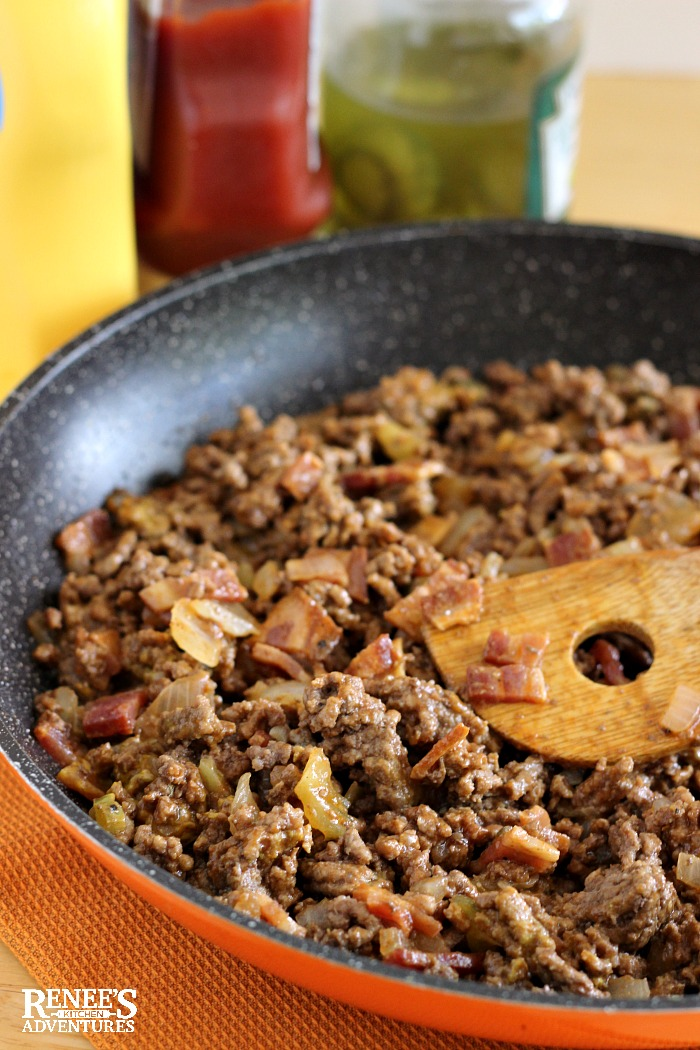Cheeseburger Casserole Recipe seasoned ground beef in pan with bacon