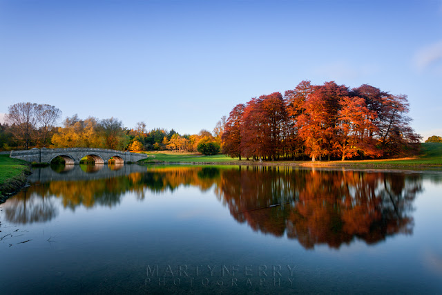 Blenheim park lake reflects the autumn colours by Martyn Ferry Photography