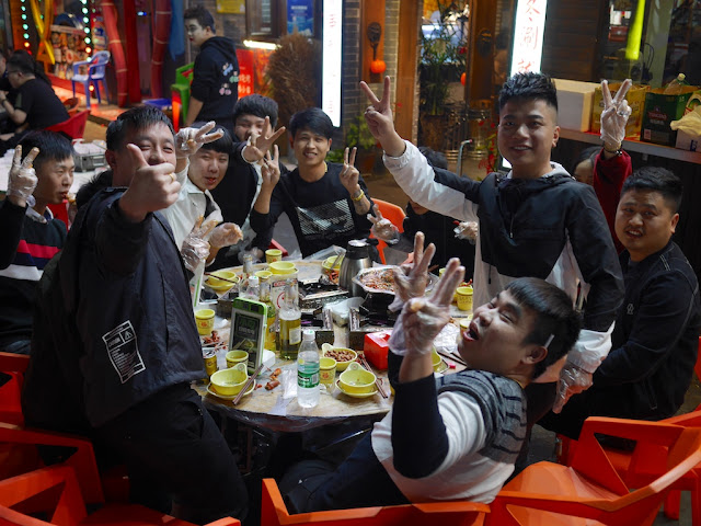 young men enjoying a late night meal outside in Changsha