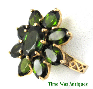 https://timewasantiques.net/products/green-tourmaline-flower-form-1970s-ring-14kt-gold-cluster-engagement-ring-dinner-ring