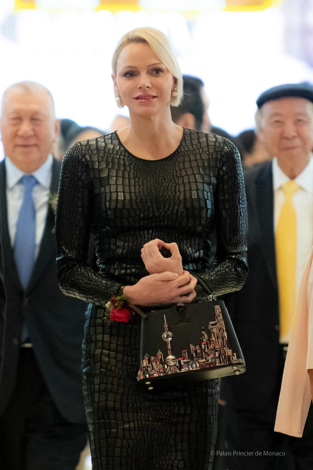 Princess Charlene Wears a black Tom Ford dress to Open Princess Grace Exhibition in Macau