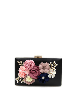 https://www.stylewe.com/product/black-appliqued-evening-clutch-99153.html