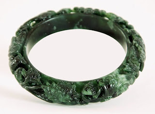 Carved jade bangle from China