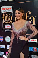 Hansika Motwani in Glittering Deep Neck Transparent Leg Split Purple Gown at IIFA Utsavam Awards 22.JPG