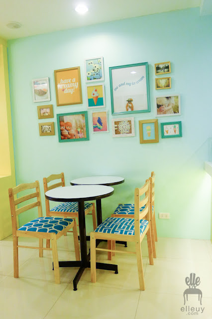ice cream shop interior, teal and yellow shop, kreamy island, frame gallery, gallery wall
