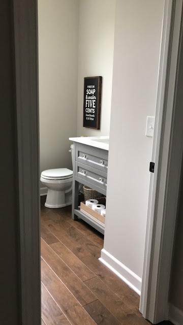 light gray vanity powder room