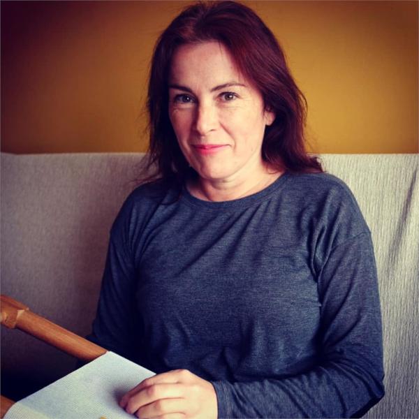 Headshot of Emily Peacock Needlepoint Designer