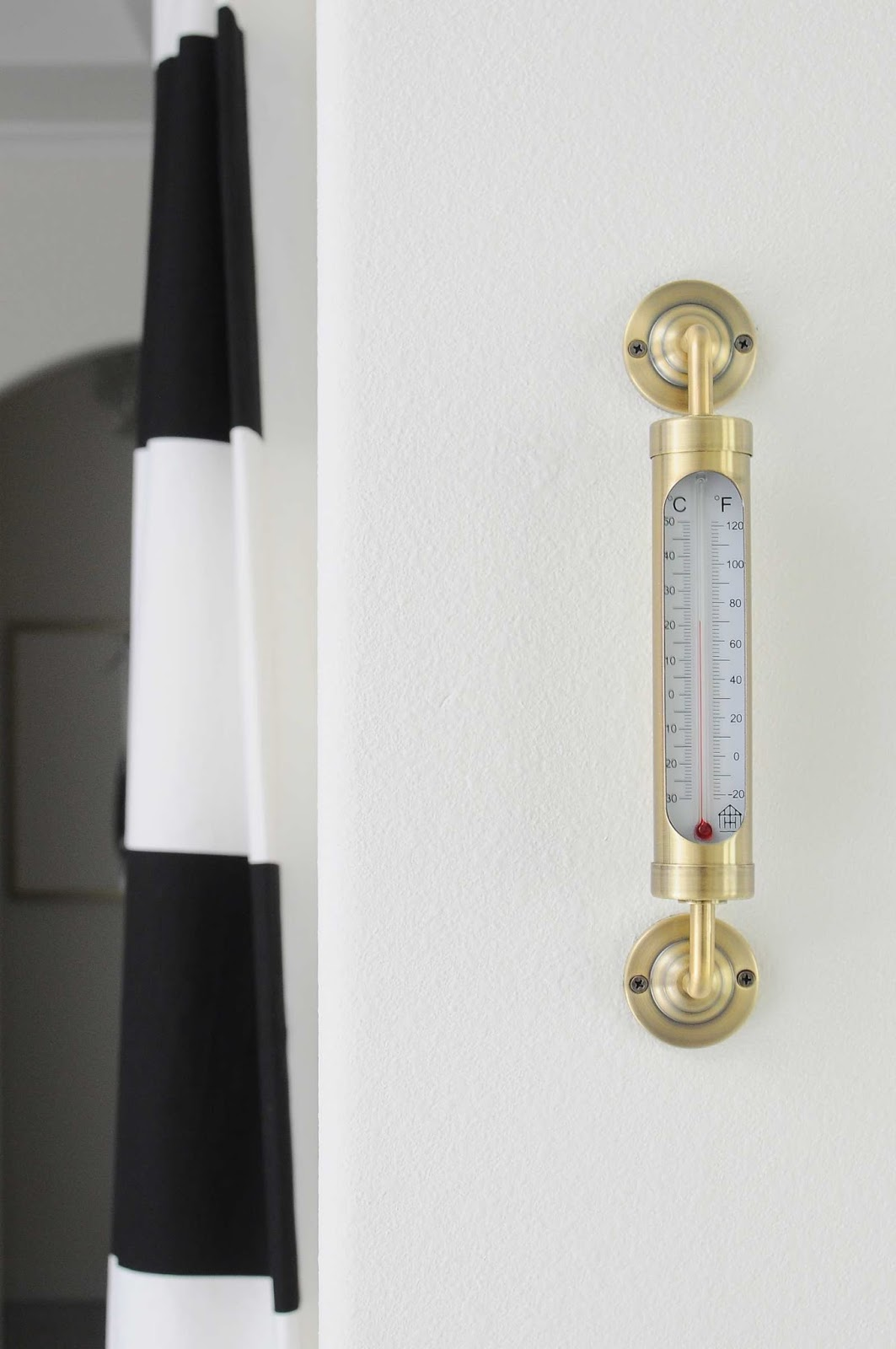 Gorgeous brass and gold thermometer.