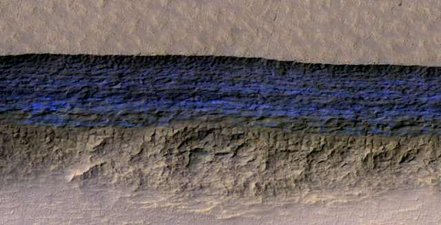 This high-resolution NASA HiRISE image shows a detailed subsection of an icy scarp on Mars in enhanced color.  Credit: NASA/JPL/University of Arizona/USGS