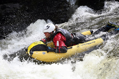 A White water bug with man racing down river