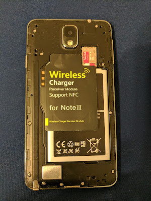 The Qi compatible wireless charging receiver coil card, positioned correctly.