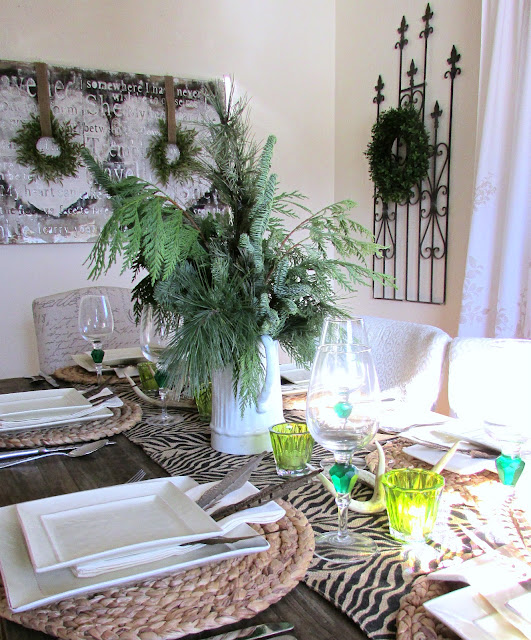 Winter Tablescape with Tons of Texture using leftover Holiday Greens, Antlers and Animal Print