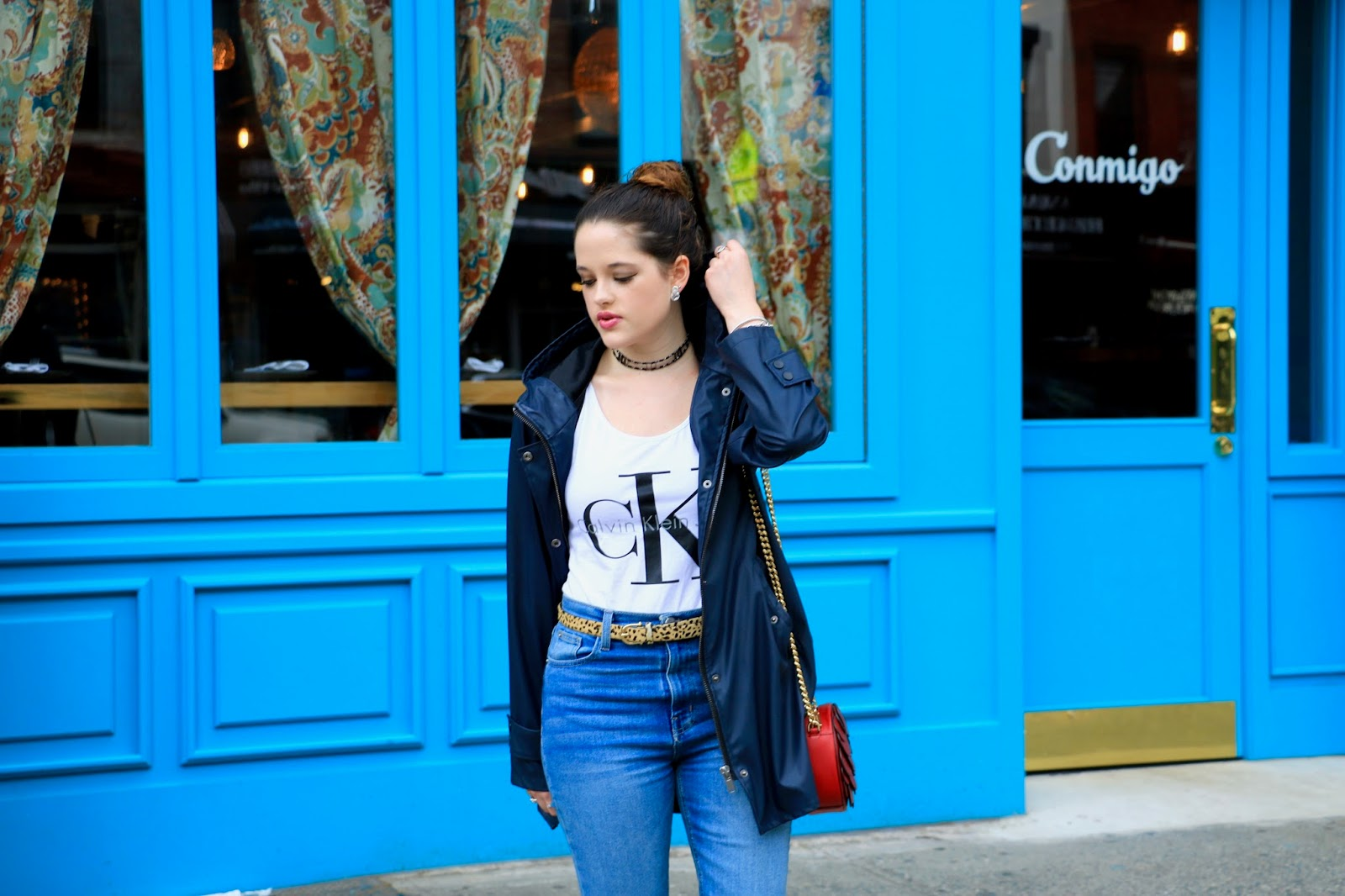 NYC fashion blogger Kathleen Harper wearing navy rain jacket with jeans