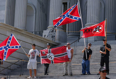 Ku Klux Klan protests removal of Confederate flag in South Carolina.