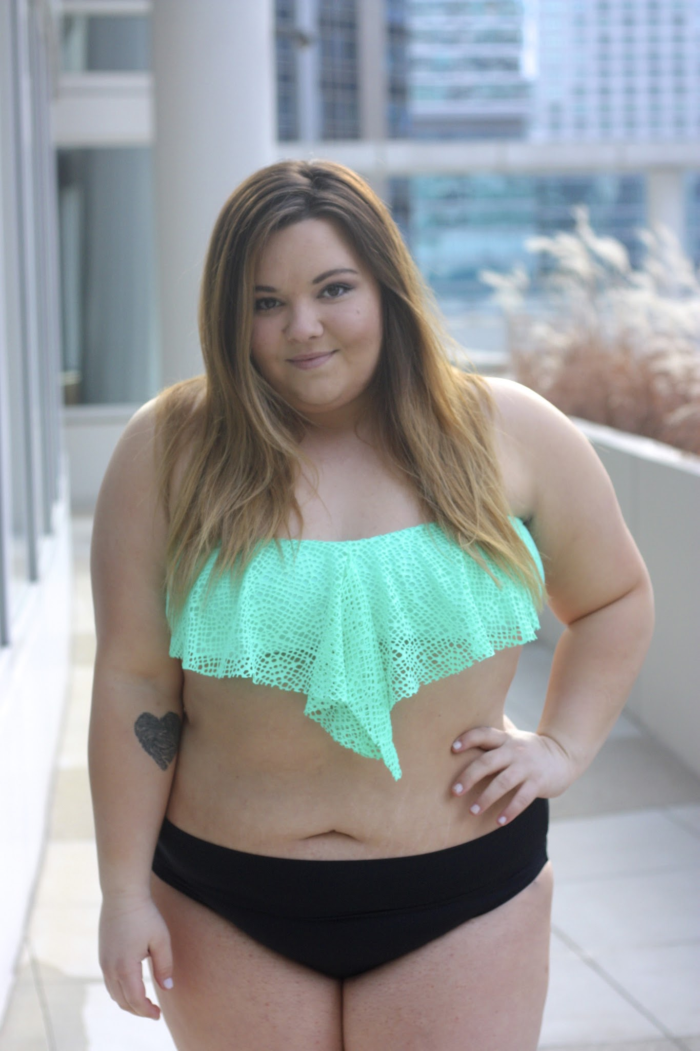 Petite and plus size fashion blogger Natalie in the city shares her favorite target bikinis and one pieces and talks about body confidence.