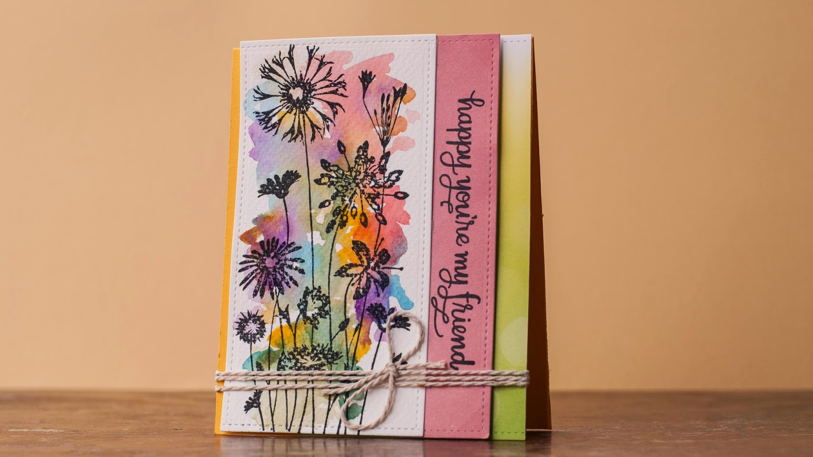 watercolor card, stamping image with black on top of watercolor