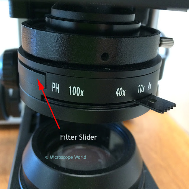 Microscope condenser image with slider inserted.