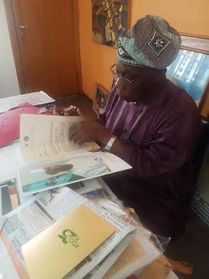 Obasanjo pictured perusing through his invitation to Kogi @ 25 celebration